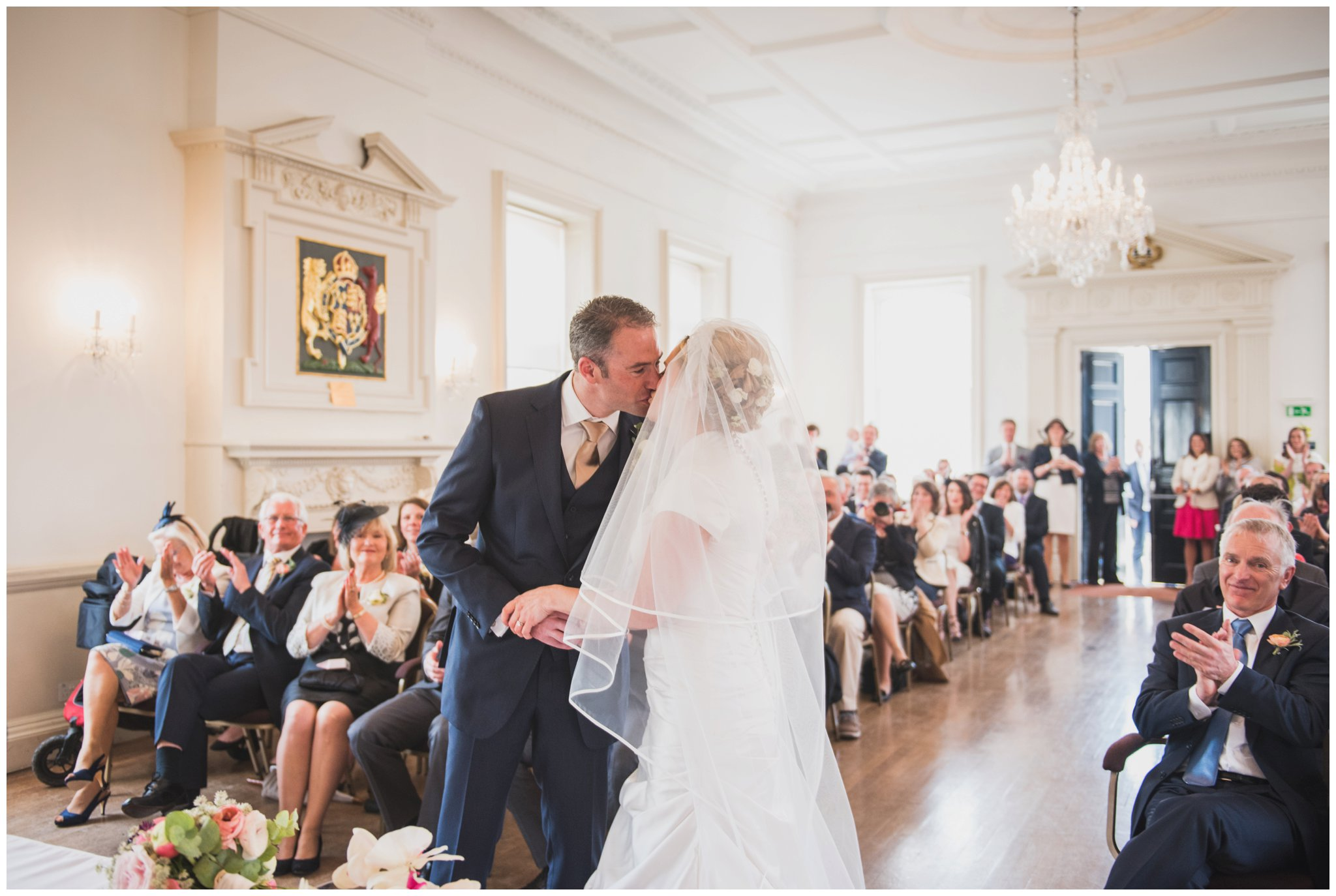 poole guildhall wedding ceremony bride and groom kissing