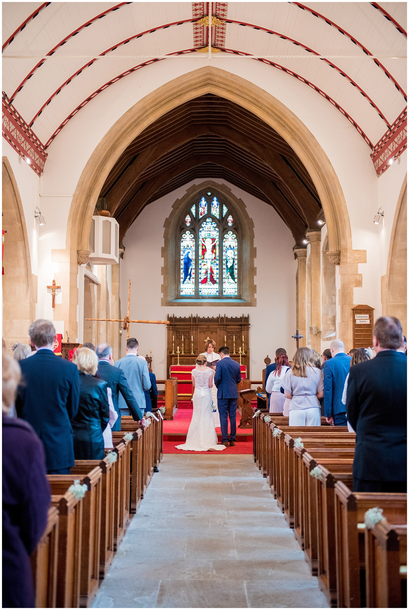 back of brides dress, long shot of the church and the congregation