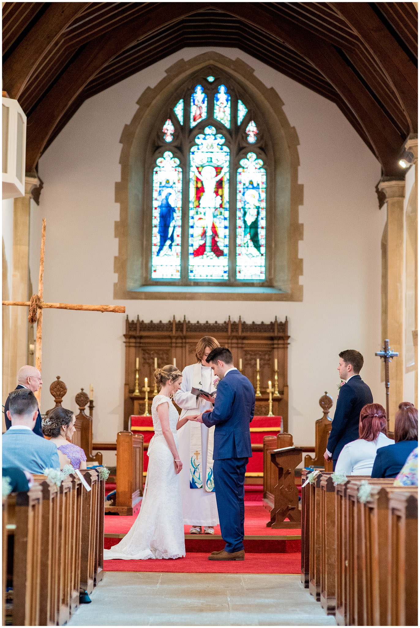 shot from the back of church bride and groom exchanging wedding rings