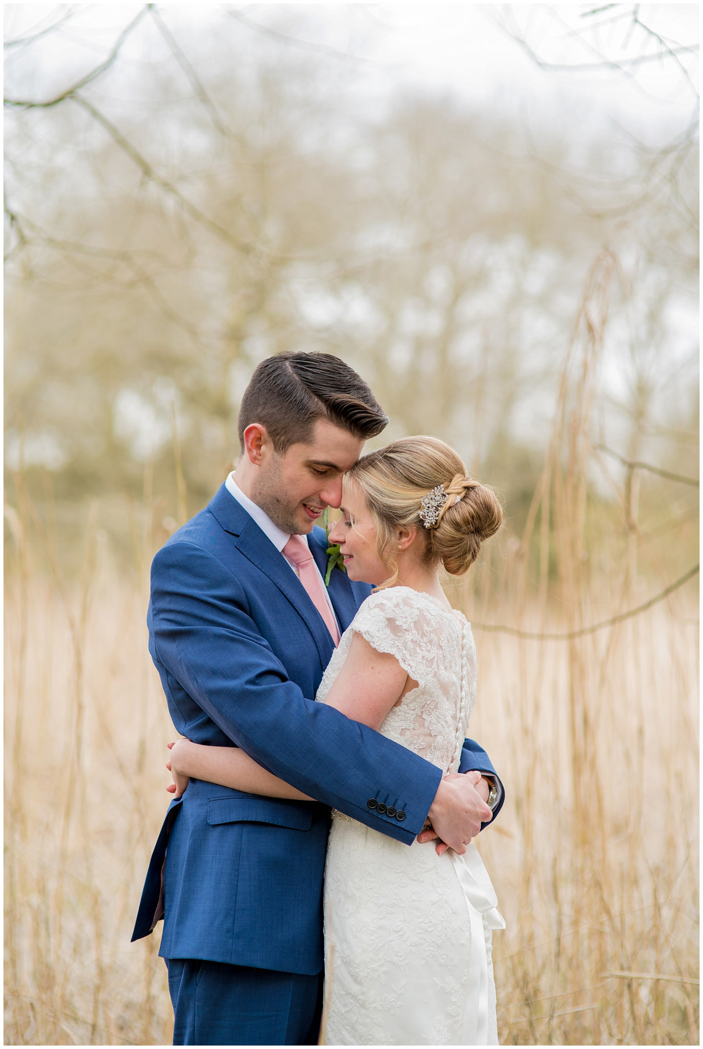 bride and groom in loving embrace